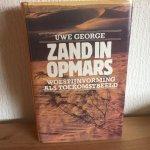 George - Zand in opmars / druk 1